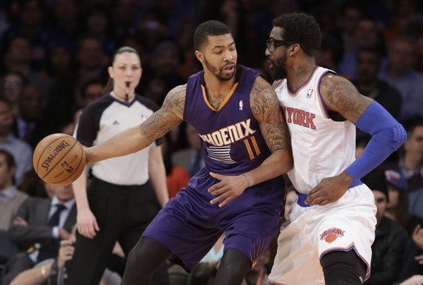 Phoenix Suns' Markieff Morris (11) is defended by New York Knicks' Amar'e Stoudemire (1) during the first half of an NBA basketball game, Monday, Jan. 13, 2014, in New York. (AP Photo/Frank Franklin II)