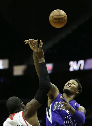 Sacramento Kings shooting guard Ben McLemore (16) battles Atlanta Hawks power forward Paul Millsap on a jump-ball in the first half of an NBA basketball game on Wednesday, Dec. 18, 2013, in Atlanta. (AP Photo/John Bazemore)