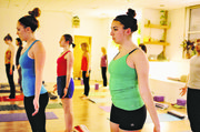 Yoga students prepare for the start of a Hot Hatha class at OmTree Shala, 1405 Massachusetts St.