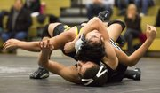 Free State sophomore Quailan Fowler, bottom wraps up Topeka High's JP Gallegos during their 113# wresting match, Thursday evening at FSHS.