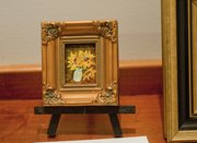 """Tiny Sunflowers in Jar,"" by artist Mary Brungardt, is part of the Itty Bitty Picture Show"