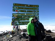 Liz Dobbins, left, and Cheryl Denton at the summit of Mt. Kilimanjaro in Africa, 19,341 feet. The Lawrence women, who got home Wednesday, spent nine days climbing and descending the mountain.