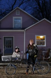 East Lawrence resident Lane Eisenbart is pictured with her 7-year-old daughter, Ro O'Leary, and the modified basket bicycle they take to the grocery store. Eisenbart, who doesn't have a car, lives in one of Lawrence's four federally designated food deserts.