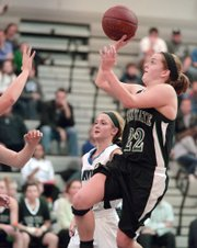 Free State's Scout Wiebe (22) gets up for shot as Free State girls played Olathe Northwest on Friday, Jan. 17, 2014.