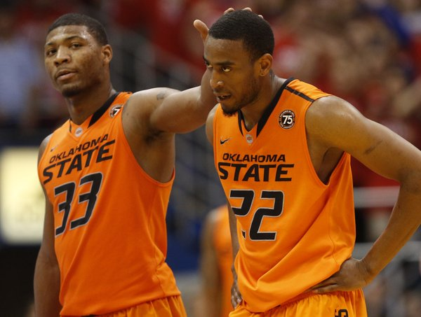 Oklahoma State guard Markel Brown (22) walks off the court after his second technical with teammate Marcus Smart during the second half on Saturday, Jan. 18, 2014 at Allen Fieldhouse.