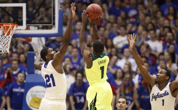 Kansas players Joel Embiid (21) and Wayne Selden defend against a three from Baylor guard Kenny Chery during the first half on Monday, Jan. 20, 2014 at Allen Fieldhouse.