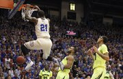 Kansas center Joel Embiid delivers a dunk before the Baylor defense during the first half on Monday, Jan. 20, 2014 at Allen Fieldhouse.