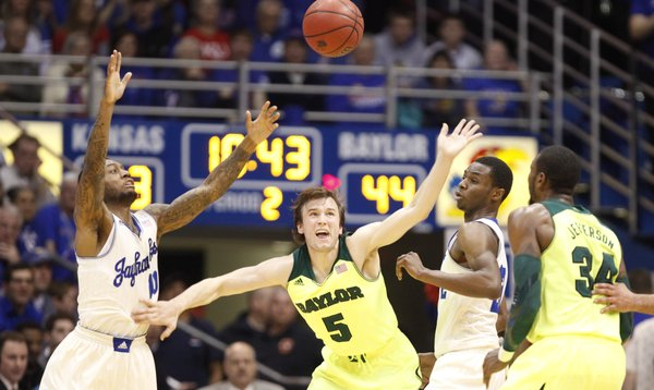 Kansas players Naadir Tharpe, left, and Andrew Wiggins hound Baylor guard Brady Heslip (5) during the second half on Monday, Jan. 20, 2014 at Allen Fieldhouse. Also pictures is Baylor forward Cory Jefferson.