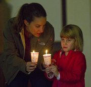 Loretta Severin and her daughter Ellorie, 5, both of Lawrence took part in a candlelight walk from Strong Hall to the Kansas Union where they celebrated Martin Luther King Jr. Day with a candlelight vigil.
