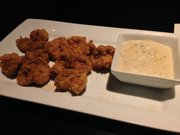 Turkey fries, or deep fried turkey testicles, are a traditional Midwest dish served at Six Mile Chop House.