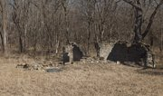 An old stone foundation rests at 1180 E. 1400 Road south of Lawrence, the location of the Upper Wakarusa River Crossing. The crossing — used by pioneers on the Oregon and California trails — has been added to the National Register of Historic Places.