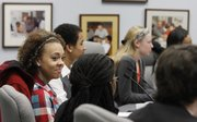 Lawrence High school senior Makayla Bell, left, joins other high school students in a panel discussion on racial issues with district administrators Wednesday.