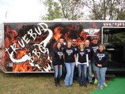 Truebud BBQ beat thousands of competitive barbecue teams nationwide to win Team of the Year for 2013, the Kansas City Barbeque Society's annual points chase. Pitmaster Tim Grant of Tonganoxie and Boyd Abts of Eudora cooked at 41 competitions last year (though Abts missed one). Pictured are, back row from left, Brian Rogers, Travis Trumper, Grant and Abts; and, front row, Carolyn Rogers, Traci Trumper, Christy Brown and Angie Abts.