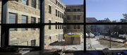 The construction site for the new addition to Marvin Hall is viewed outside the windows of the walkway between Marvin and the Fine Arts building on the Kansas University campus.