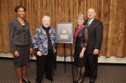 Saralyn Reece Hardy, second from right, was named the inaugural recipient of the Spencer Museum of Art Marilyn Stokstad Directorship on Jan. 24, 2014. Left to right are Kansas University Chancellor Bernadette Gray-Little, Stokstad, Reece Hardy and Dale Seuferling, KU Endowment  president.