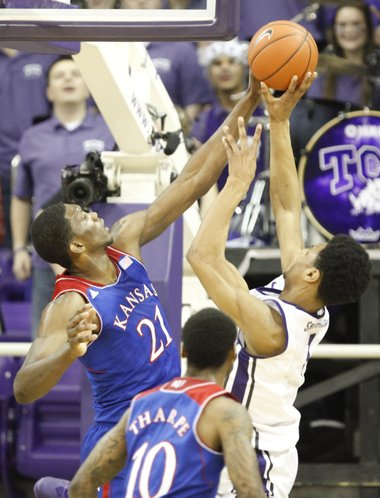 Kansas center Joel Embiid stuffs a shot by TCU center Karviar Shepherd during the first half on Saturday, Jan. 25, 2014 at Daniel-Meyer Coliseum in Fort Worth, Texas.