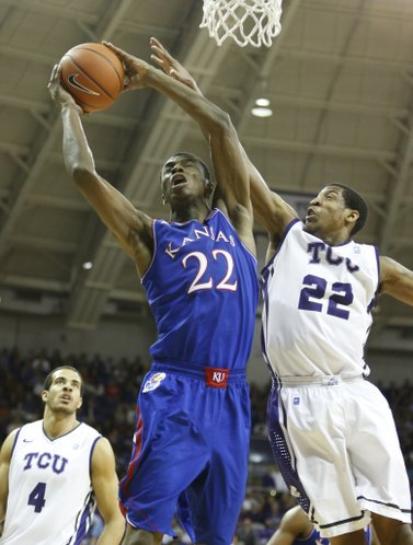 Kansas guard Andrew Wiggins gets a put-back bucket against TCU guard Jarvis Ray during the second half on Saturday, Jan. 25, 2014 at Daniel-Meyer Coliseum in Fort Worth, Texas.