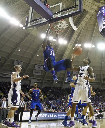 Kansas forward Jamari Traylor dunks over TCU guard Jarvis Ray (22) during the second half on Saturday, Jan. 25, 2014 at Daniel-Meyer Coliseum in Fort Worth, Texas.