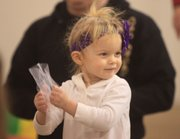 Violet Russell, holds a 'snowflake' as she dances around a class taught by Sarah Niileksela, a practicing music therapist, who teaches a class at Jump for Joy 1035 E 23rd St. in Lawrence.