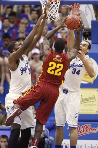 Kansas players Joel Embiid, left, and Perry Ellis defend against a shot from Iowa State forward Dustin Hogue during the first half on Wednesday, Jan. 29, 2014 at Allen Fieldhouse.