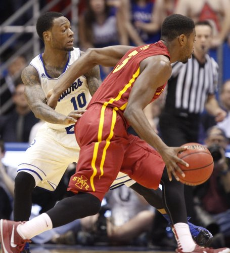 Kansas guard Naadir Tharpe defends as Iowa State forward Melvin Ejim drives during the first half on Wednesday, Jan. 29, 2014 at Allen Fieldhouse.
