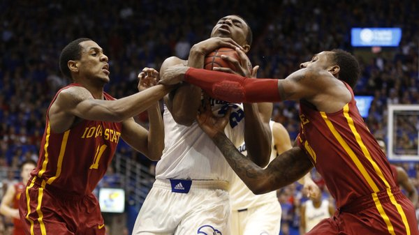 Kansas guard Andrew Wiggins drives to the bucket between Iowa State players Monte Morris, left, and DeAndre Kane during the second half on Wednesday, Jan. 29, 2014 at Allen Fieldhouse.