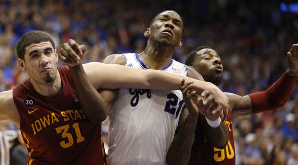 Kansas center Joel Embiid battles for position with Iowa State defenders Georges Niang, left, and DeAndre Kane during the second half on Wednesday, Jan. 29, 2014 at Allen Fieldhouse.