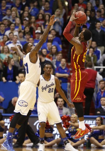 Kansas forward Jamari Traylor gets a hand in the face of Iowa State guard DeAndre Kane as he puts up a three late in the second half on Wednesday, Jan. 29, 2014 at Allen Fieldhouse.