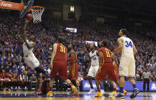 Kansas center Joel Embiid lunges for a bucket after an Iowa State foul during the first half on Wednesday, Jan. 29, 2014 at Allen Fieldhouse.