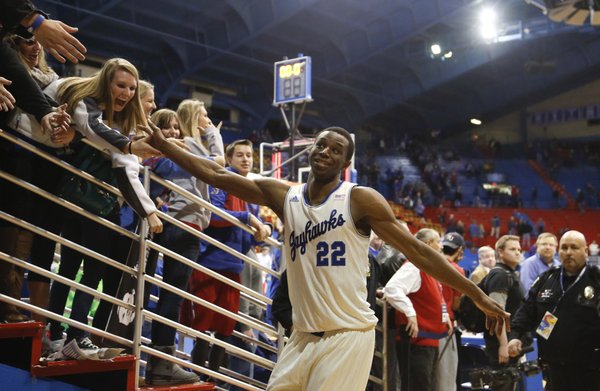 Kansas guard Andrew Wiggins slaps hands with the Jayhawk faithful as he leaves the court following a career high, 29 points against Iowa State in the Jayhawks' 92-81 win, Wednesday, Jan. 29, 2014 at Allen Fieldhouse.