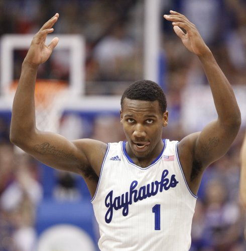 Kansas guard Wayne Selden raises up the fieldhouse during a Jayhawk run against Iowa State during the second half on Wednesday, Jan. 29, 2014 at Allen Fieldhouse.