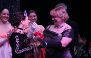 Outgoing diva champion Sarah Young, right, congratulates Erica Fox for winning last year's Dueling Divas event at Theatre Lawrence.