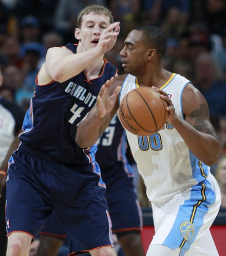 Charlotte Bobcats center Cody Zeller, left, stops Denver Nuggets forward Darrell Arthur as he works the ball inside for a shot in the first quarter of an NBA basketball game in Denver on Wednesday, Jan. 29, 2014. (AP Photo/David Zalubowski)