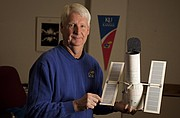Kansas University Professor Steven Hawley, a former astronaut, holds a model of the Hubble Space Telescope in this Journal-World file photo from January 2014.