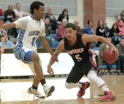 Lawrence's Justin Roberts (5) reverses his direction in the Lions' 82-60 victory Friday, Jan. 31, 2014, in Leavenworth.