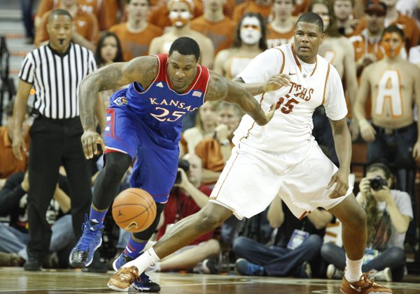 Kansas forward Tarik Black battles for a loose ball with Texas center Cameron Ridley during the first half on Saturday, Feb. 1, 2014 at Erwin Center in Austin, Texas.