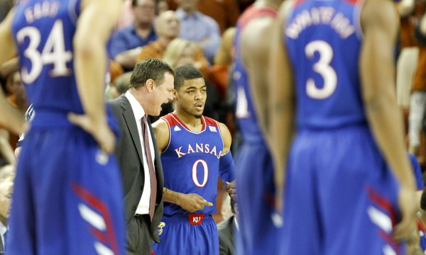 Kansas head coach Bill Self rips into point guard Frank Mason after Mason was issued a flagrant foul during the first half on Saturday, Feb. 1, 2014 at Erwin Center in Austin, Texas.