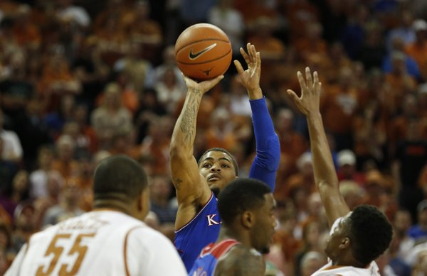 Kansas guard Frank Mason puts up a three against Texas guard Isaiah Taylor during the second half on Saturday, Feb. 1, 2014 at Erwin Center in Austin, Texas.