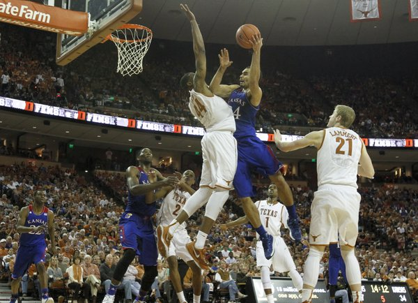 Kansas forward Perry Ellis turns for a shot against Texas center Prince Ibeh during the second half on Saturday, Feb. 1, 2014 at Erwin Center in Austin, Texas.