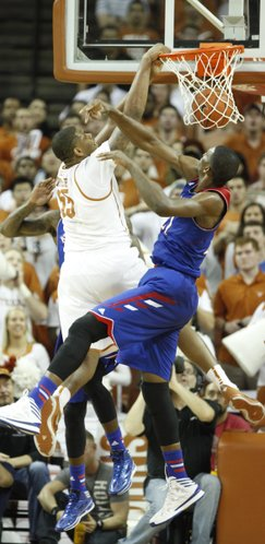 Texas center Cameron Ridley throws down a dunk before Kansas center Joel Embiid after being fouled during the second half on Saturday, Feb. 1, 2014 at Erwin Center in Austin, Texas.