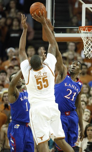 Texas center Cameron Ridley turns for a shot over Kansas center Joel Embiid (21) and guard Wayne Selden during the first half on Saturday, Feb. 1, 2014 at Erwin Center in Austin, Texas.