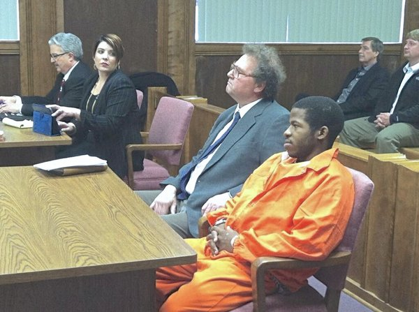 lad in an orange jumpsuit, David Bennett hears various charges against him, including four counts of first-degree murder, for allegedly killing a young Parsons mother and her three children. Bennett was sent to Osawatomie State Hospital a few weeks before the slayings after police said he made threats of murder and suicide on Facebook. Hospital officials released him after concluding he was not a danger to himself or others. His alleged killings and two others in Eureka by another former state hospital patient have prompted many to question the adequacy of the state's system for dealing with the mentally ill. Photo courtesy KWCH-TV.