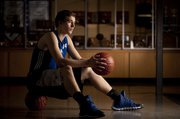"Zach Linquist, a senior power forward for Perry-Lecompton High, learned that he had leukemia on Oct. 2, 2013. In talking about the show of support from those around him, Linquist said, ""It&squot;s unbelievable. My team, my community and my family have been the ones helping me through this and giving me strength."""