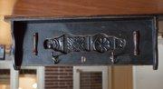 Shelf with hooks, $77.95, from M. Street Interiors, 825 Massachusetts St.