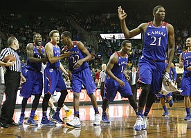 From left Jamari Traylor and Brannen Greene congratulate Andrew Wiggins, center, after Wiggins hit a long three-point basket to end the first half. Also celebrating at right are Wayne Selden and Joel Embiid Tuesday, Feb. 4, 2014 at Ferrell Center in Waco, Texas.