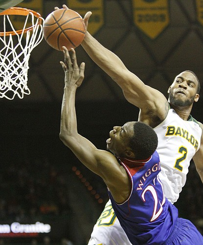 Baylor forward Rico Gathers blocks a shot from Andrew Wiggins, but got called for a foul during the second half of the Jayhawks' win over the Baylor Bears Tuesday, Feb. 4, 2014 at Ferrell Center in Waco, Texas.