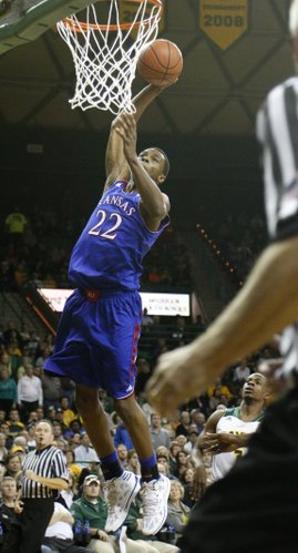 Kansas guard Andrew Wiggins leaps to put down a runaway dunk in the second half of the Jayhawks' win over Baylor Tuesday, Feb. 4, 2014 at Ferrell Center in Waco, Texas.