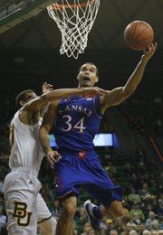 Kansas forward Perry Ellis puts up a shot against Baylor center Isaiah Austin during the first half on Tuesday, Feb. 4, 2014 at Ferrell Center in Waco, Texas.