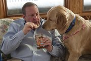 David Lawhorn and his dog, Dexter, enjoy some chips and salsa that David has created. The salsa spans four varieties, from original to Dexter's Wrath.