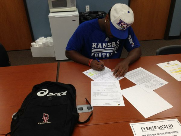 Damani Mosby of Mesa C.C., signing his letter of intent to join the Jayhawks.